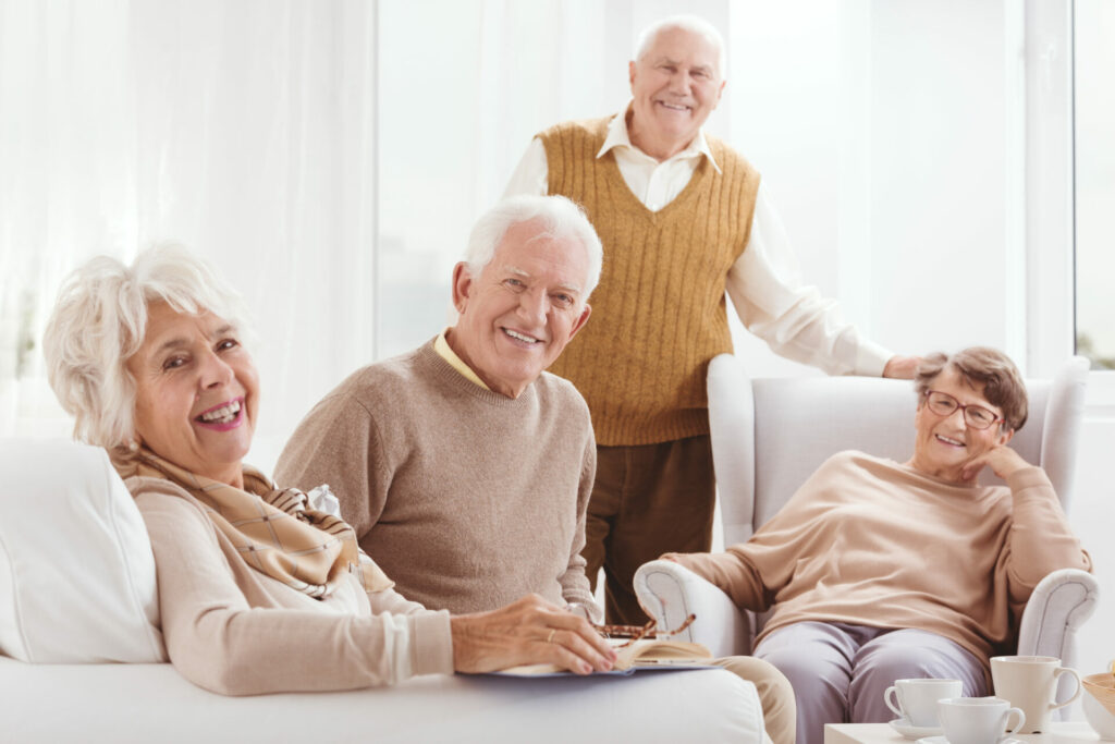 Group of elderly people smiling at a day care facility