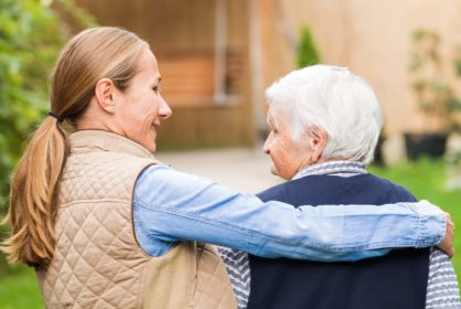 Carer_walking_with_the_elderly_woman__Dementia_Care__Elder